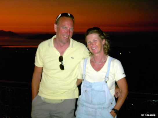 Blogger and husband at Zia - enjoying the beautiful sunset over the Greek islands